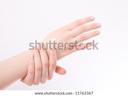 female applying cream to her hands / copyspace - stock photo