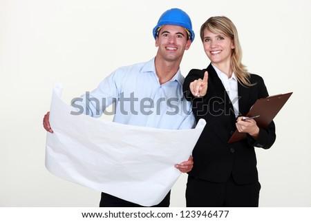 female architect and foreman holding plans - stock photo