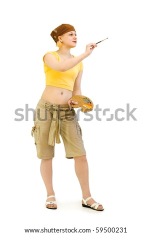 Female Artist paints with a palette in his hands - stock photo