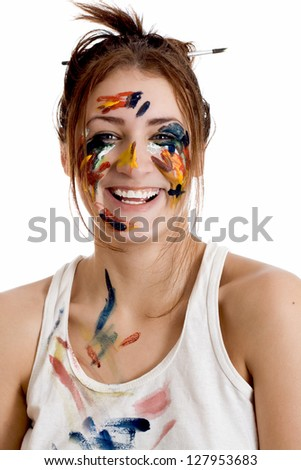 Female artist with paint smeared face isolated on white background - stock photo