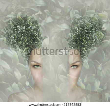 Female artistic portrait divided in two parts, surreal concept - stock photo