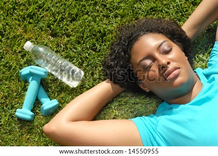 Female athlete taking a break during a workout - stock photo