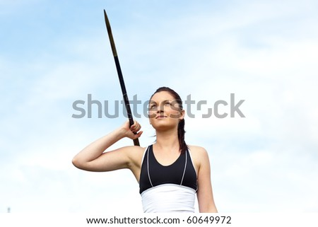 Female athlete throwing the javelin outdoors - stock photo