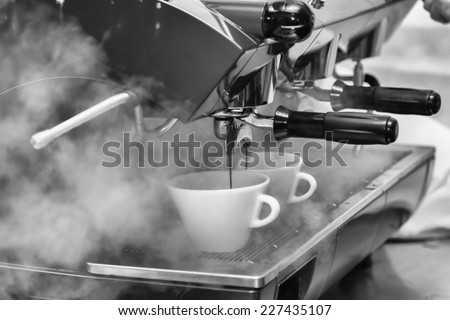 Female bartender in the workplace. Girl makes coffee using coffee machine. Coffee, cappuccino, coffee, coffee shop, the bartender - the concept of catering. Use in articles about coffee. - stock photo