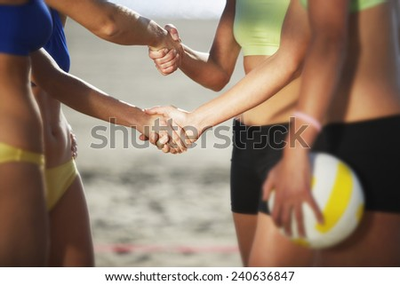 Female Beach Volleyball Players Shaking Hands - stock photo