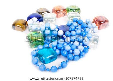Female beads and glass stones of a knickknack isolated on a white background - stock photo