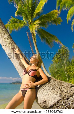 Female Beauty On a Tropical Beach  - stock photo
