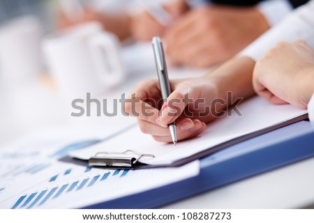 Female being ready to take notes at seminar - stock photo