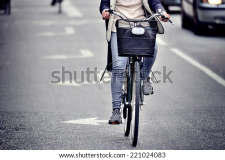Female bicyclist on the street - stock photo
