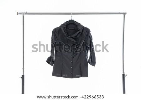 Female black clothing on hanging  - stock photo