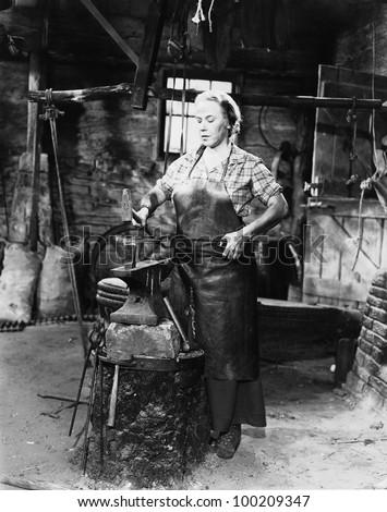 Female blacksmith - stock photo