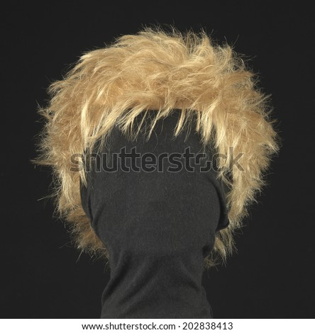 female blonde wig on a black background - stock photo