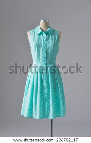 female blue sundress on mannequin-gray background  - stock photo