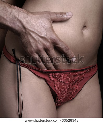 female body with male hand - stock photo