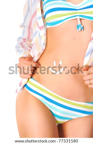 female body with protecting cream in form of smile - stock photo