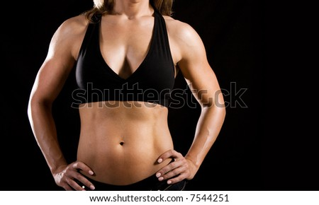 female bodybuilder's toned body - stock photo