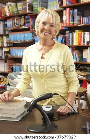 Female bookshop proprietor - stock photo