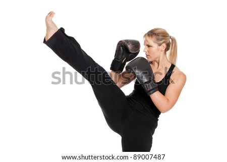 Female boxer punching isolated on a white background - stock photo