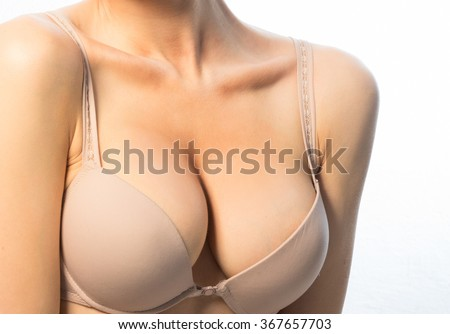 Female breast in a beige bra - stock photo