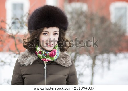 Female brunette with a wind running through her hair - stock photo