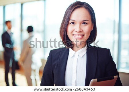 Female business leader looking at camera - stock photo
