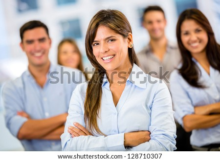 Female business leader with her team at the office - stock photo