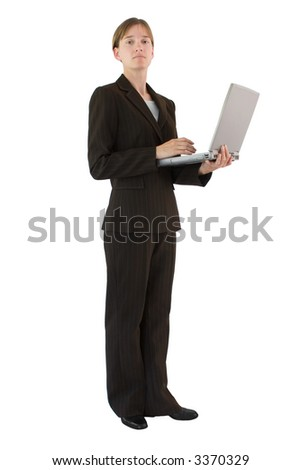 Female business professional wearing tailored suit and holding a laptop computer. Isolated on a white background. - stock photo