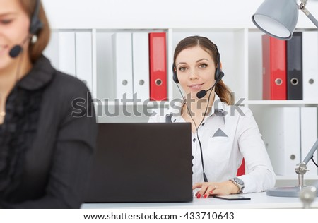Female call center service operator at work. Portrait of pretty female employee with headset at workplace. Effective and efficient business information, help and support concept - stock photo