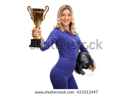 Female car racing champion holding a gold trophy and showing it towards the camera isolated on white background - stock photo