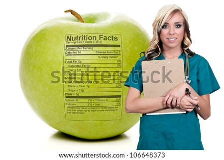 Female cardiologist holding a delicious red apple - stock photo
