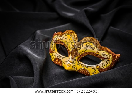 Female carnival mask on black background - stock photo