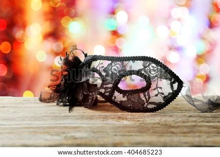 Female carnival mask on grey wooden background - stock photo