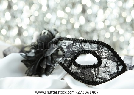 Female carnival mask with bokeh - stock photo