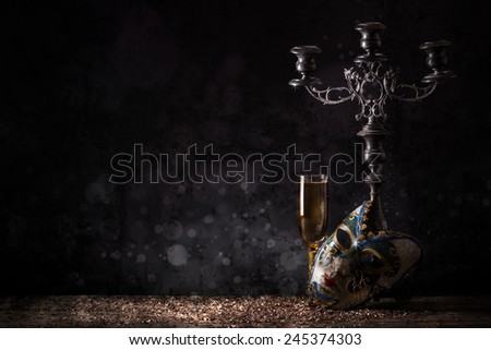 Female carnival mask with glass of champagne - stock photo