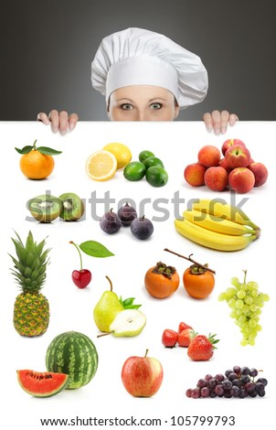 Female chef looking over fruit collection billboard - stock photo