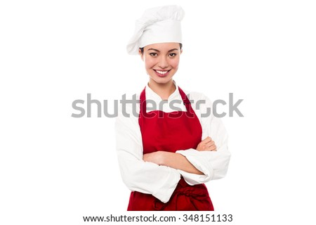 Female chef posing with arms crossed - stock photo