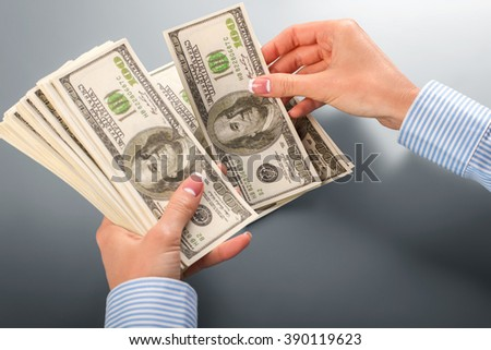 Female clerk counting dollars. Female hands counting dollar banknotes. When calculator is broken. Must do it fast. - stock photo