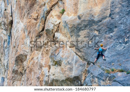 Female climber on a cliff - stock photo
