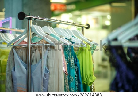 Female clothes in a fashion shop - stock photo
