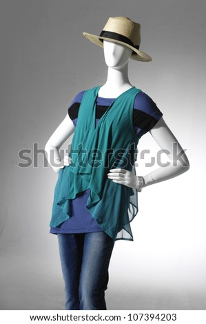 female clothing in jeans with hat on mannequin - stock photo