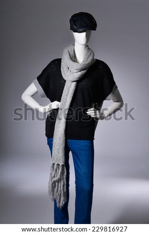 female clothing in jeans with hat ,scarf on mannequin - stock photo
