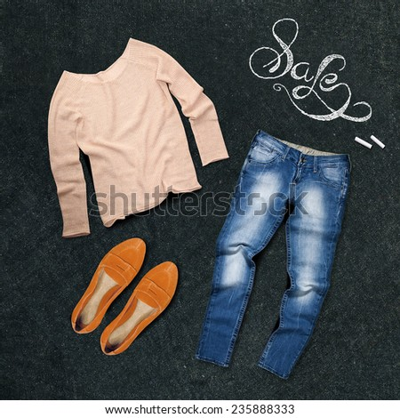 female clothing on a chalk board - stock photo