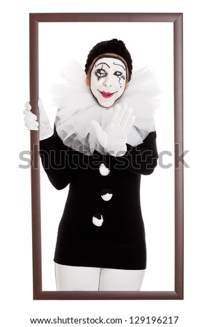 female clown in a frame stretches out hand - stock photo