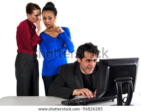 female co workers gossiping about male co worker - stock photo