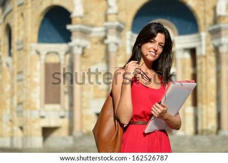 Female college student. Happy girl in european university for scholarship. Universidad Laboral, Gijon, Spain. - stock photo