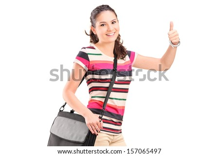Female college student with a shoulder bag giving a thumb up isolated on white background - stock photo