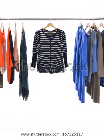 female colorful clothes on Hangers - stock photo