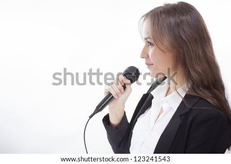 Female conference speaker in action - stock photo