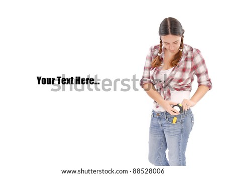 Female Construction Worker Putting Tape Measure on Hip - stock photo