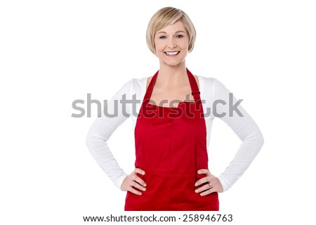 Female cook posing with hands on her waist - stock photo